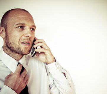 businessman-phone-tight-tie