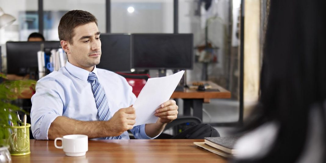 HR recruiter utilizing his recruitment skills while interviewing a candidate.