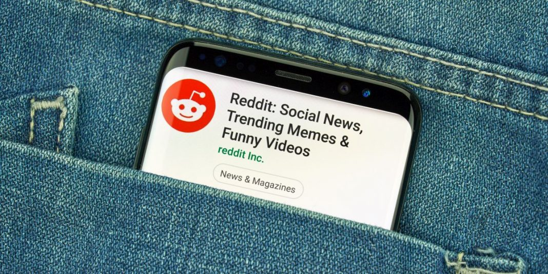 Cell phone in pocket showing results for top ways to find candidates on Reddit
