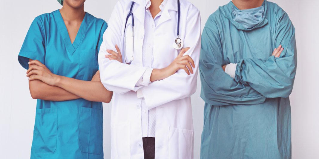 healthcare staff standing next to each other upon layoff