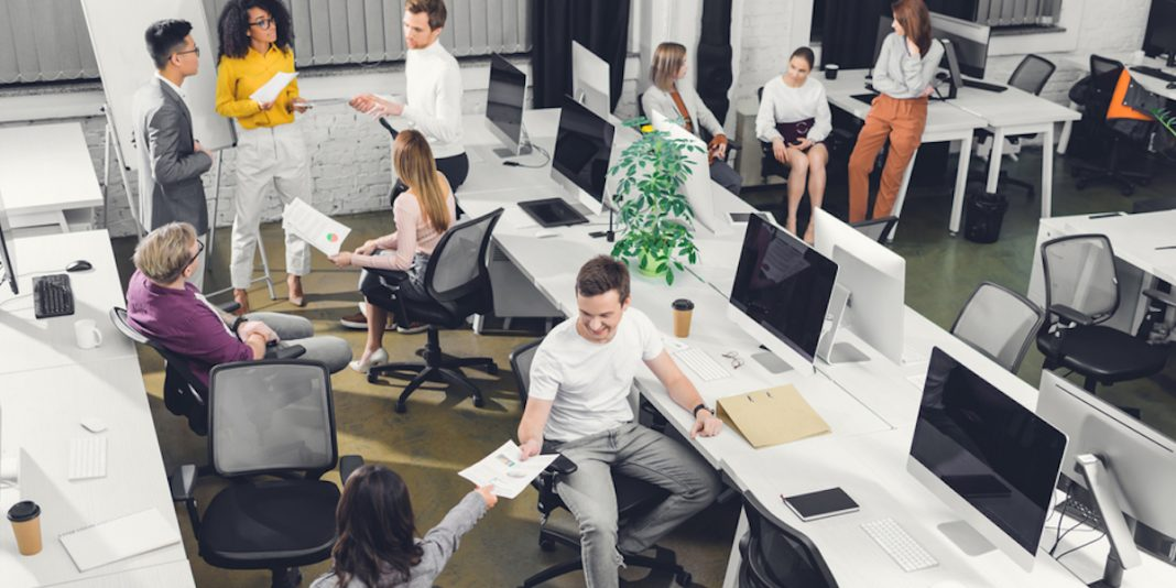 diverse employees engaging in a busy work environment.