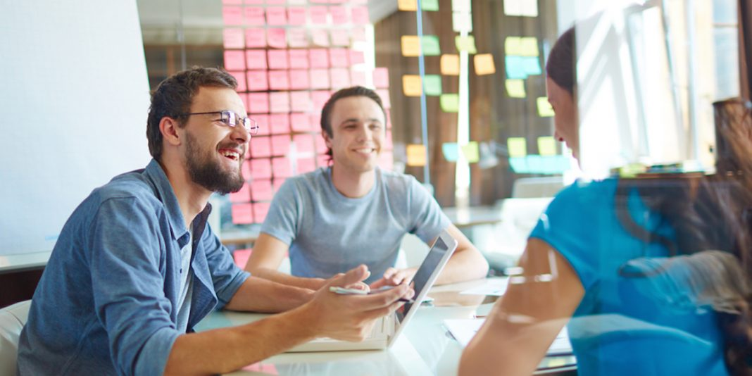 colleagues in office around table strategizing ways to recruit hourly employees