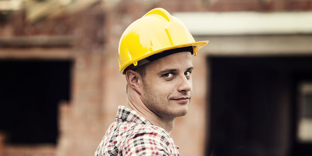 Man in construction hat and text about construction labor shortage