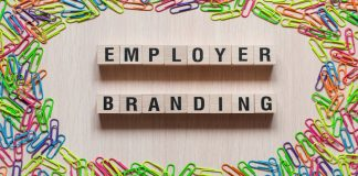 Employer branding words concept on cubes, showing where marketing and HR meet.