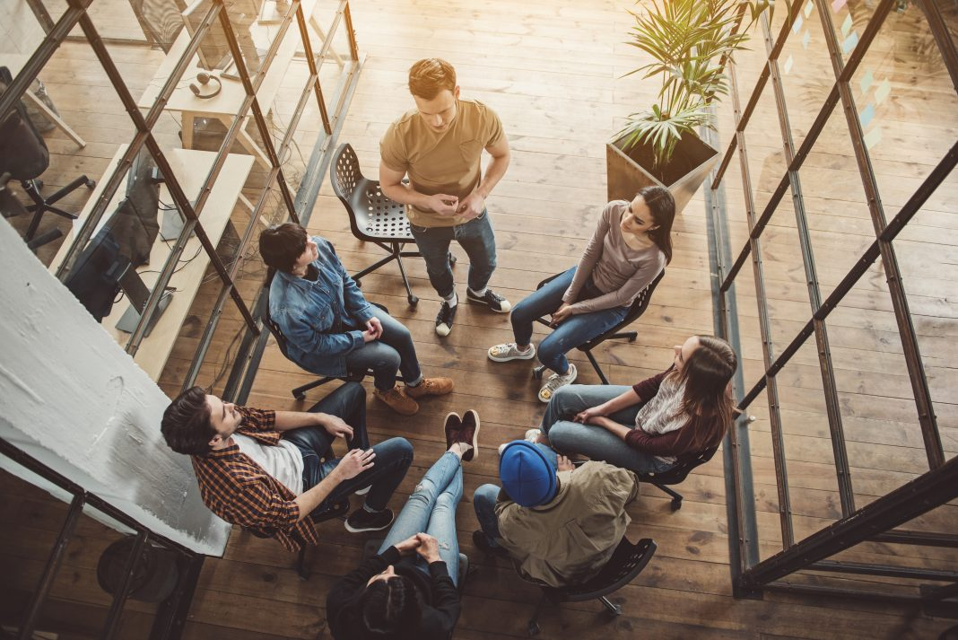group of people sitting doing 5 minute team building activities
