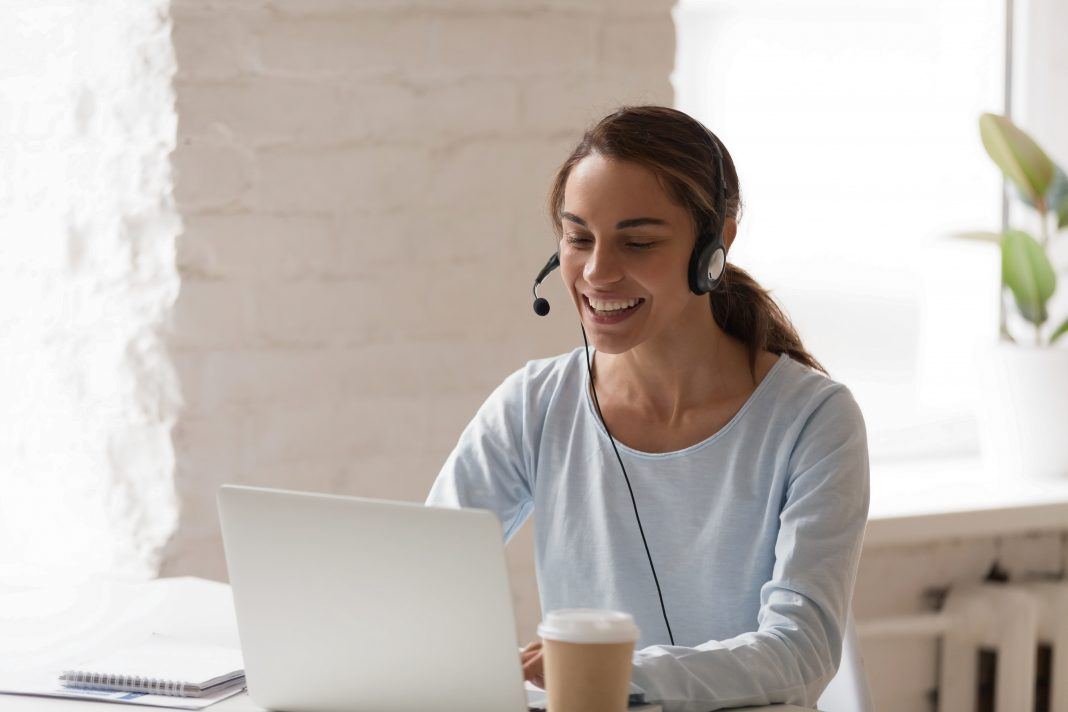 woman sitting at computer receiving outplacement counseling