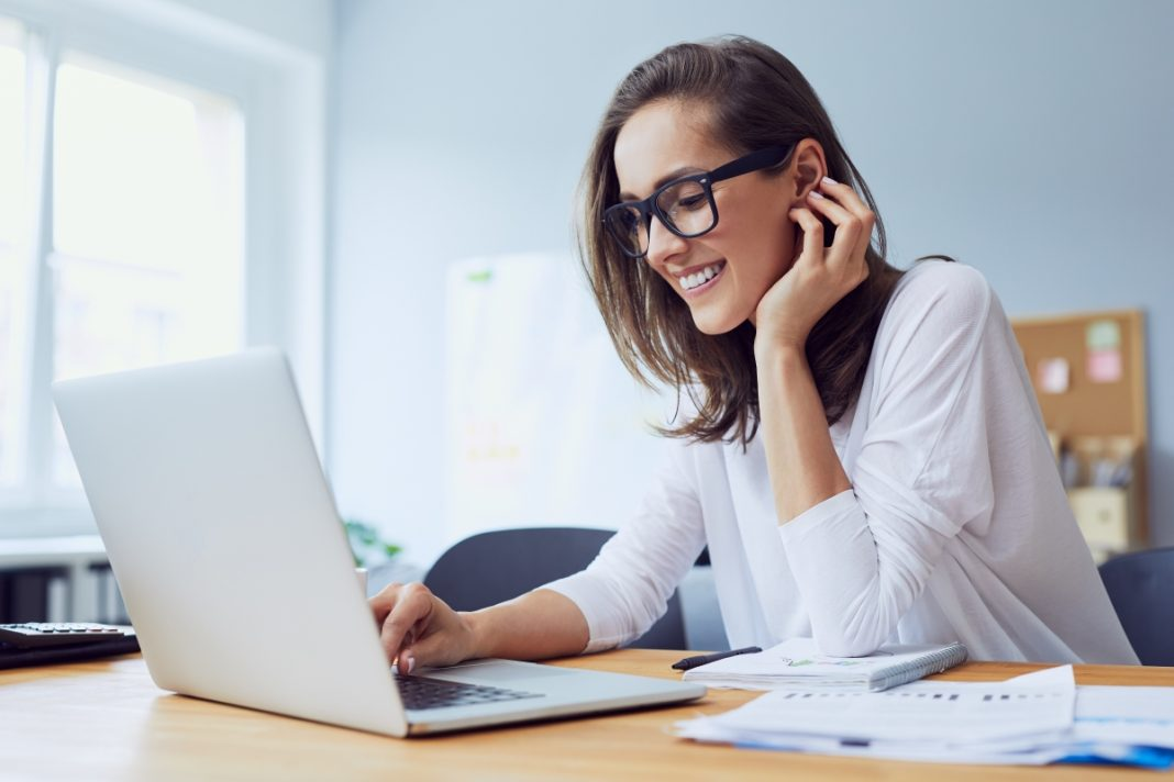 Woman at computer learning 8 Social Recruiting Strategies That Always Work