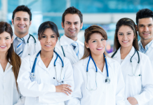 Group of healthcare professionals in workplace, overcoming top HR challenges in healthcare.
